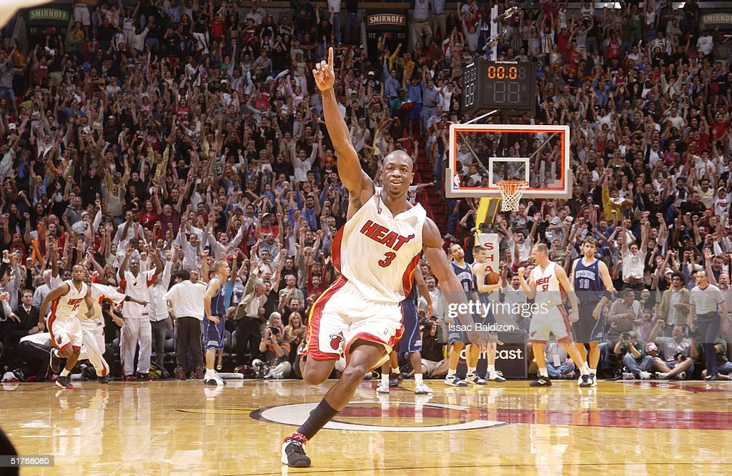 Dwyane Wade of the Miami Heat celebrates a game winning shot in overtime against the Utah Jazz November 19 2004 at American Airlines Arena in Miami...