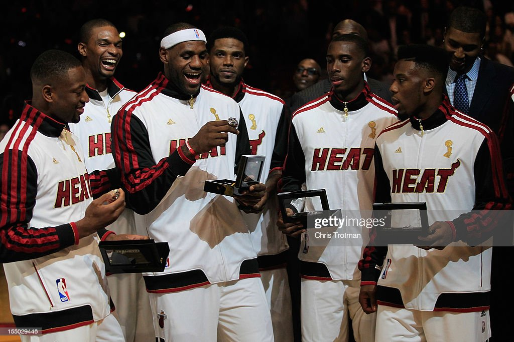 <a gi-track='captionPersonalityLinkClicked' href=/galleries/search?phrase=Dwyane+Wade&family=editorial&specificpeople=201481 ng-click='$event.stopPropagation()'>Dwyane Wade</a> #3 of the Miami Heat, (C) <a gi-track='captionPersonalityLinkClicked' href=/galleries/search?phrase=Chris+Bosh&family=editorial&specificpeople=201574 ng-click='$event.stopPropagation()'>Chris Bosh</a> #1 of the Miami Heat and (R) <a gi-track='captionPersonalityLinkClicked' href=/galleries/search?phrase=LeBron+James&family=editorial&specificpeople=201474 ng-click='$event.stopPropagation()'>LeBron James</a> #6 of the Miami Heat look at their 2012 NBA Championship rings following a ring giving ceremony prior to the game against the Boston Celtics at American Airlines Arena on October 30, 2012 in Miami, Florida. (Photo by Chris Trotman/Getty Images)