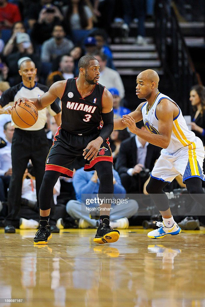 Dwyane Wade #3 of the Miami Heat controls the ball against Jarrett Jack #2 of the Golden State Warriors on January 16, 2013 at Oracle Arena in Oakland, California.