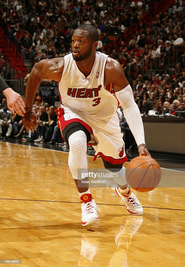 <a gi-track='captionPersonalityLinkClicked' href=/galleries/search?phrase=Dwyane+Wade&family=editorial&specificpeople=201481 ng-click='$event.stopPropagation()'>Dwyane Wade</a> #3 of the Miami Heat controls the ball during the fourth quarter against the Atlanta Hawks on January 2, 2012 at American Airlines Arena in Miami, Florida.