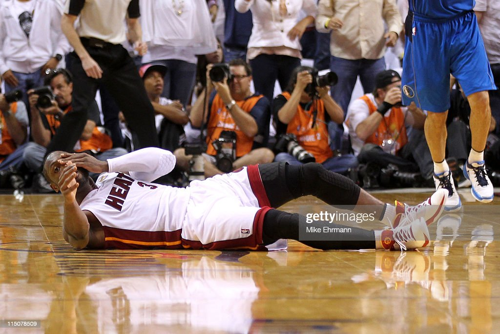 <a gi-track='captionPersonalityLinkClicked' href=/galleries/search?phrase=Dwyane+Wade&family=editorial&specificpeople=201481 ng-click='$event.stopPropagation()'>Dwyane Wade</a> #3 of the Miami Heat covers his face as he lies on the court after he missed the final field goal attempt of the game against the Dallas Mavericks in Game Two of the 2011 NBA Finals at American Airlines Arena on June 2, 2011 in Miami, Florida. The Mavericks won 95-93.