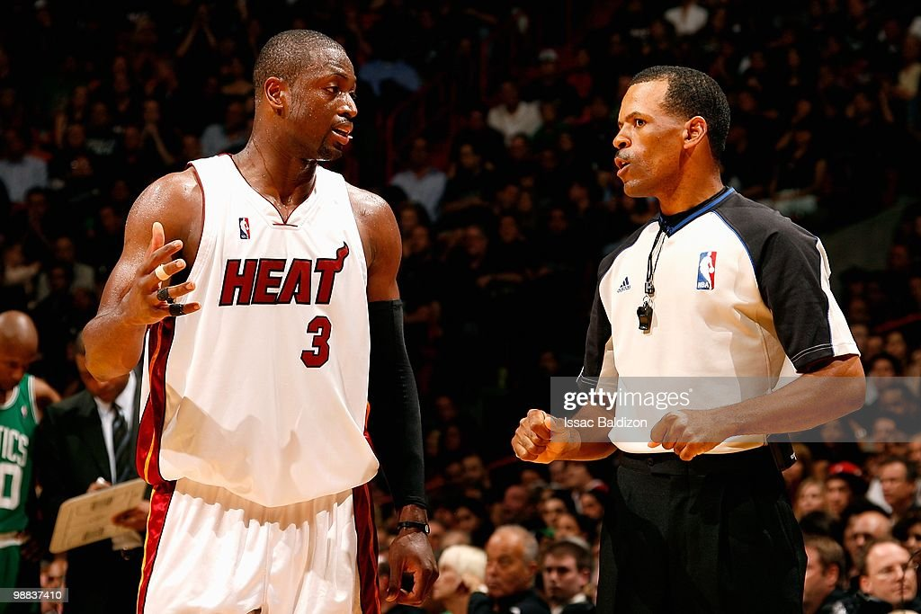 Dwyane Wade of the Miami Heat discusses a call with referee Eric Lewis in Game Three of the Eastern Conference Quarterfinals against the Boston...