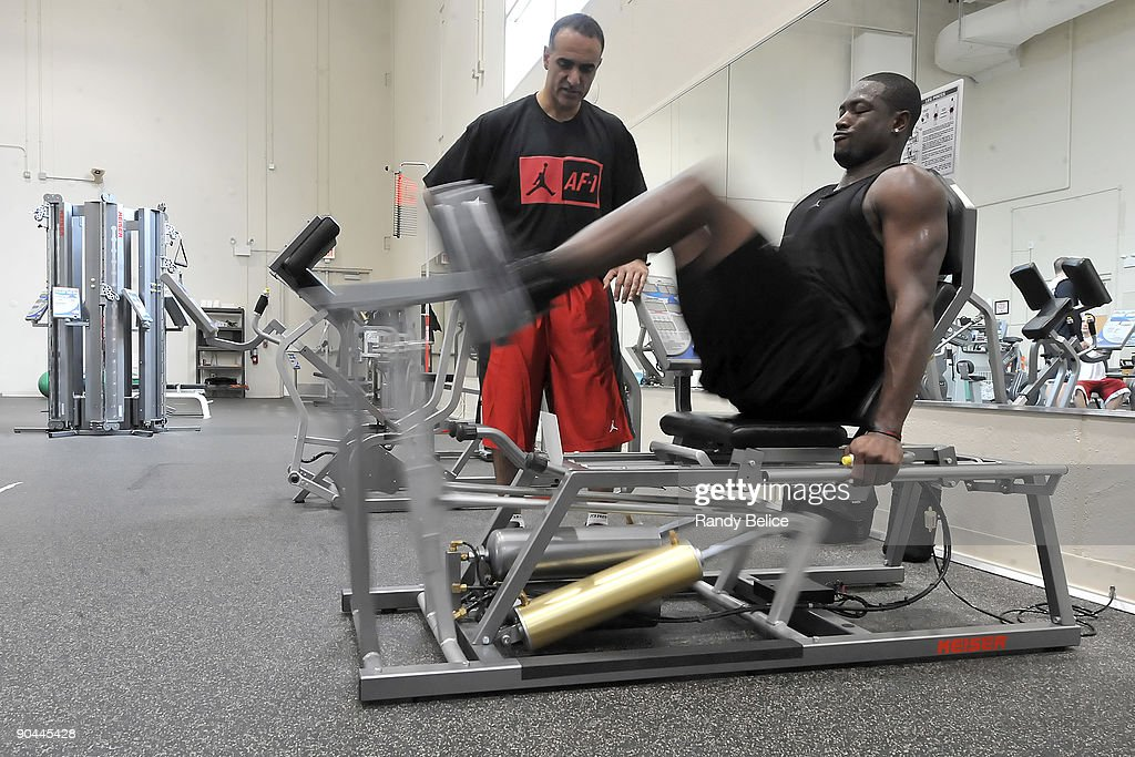 Dwyane Wade of the Miami Heat does leg presses while observed by Tim Grover, sports performance enhancement specialist and ATTACK Athletics owner, during his workout on September 8, 2009 at ATTACK Athletics in Chicago, Illinois.