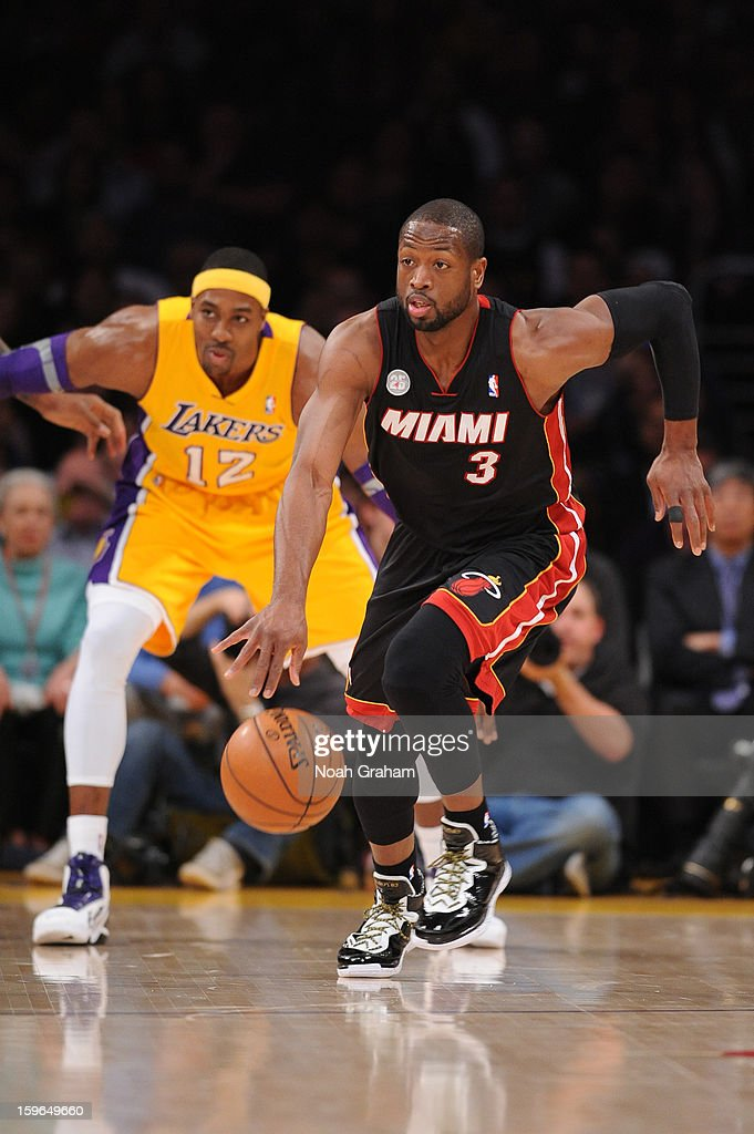 Dwyane Wade #3 of the Miami Heat dribbles the ball ahead of Dwight Howard #12 of the Los Angeles Lakers at Staples Center on January 15, 2013 in Los Angeles, California.