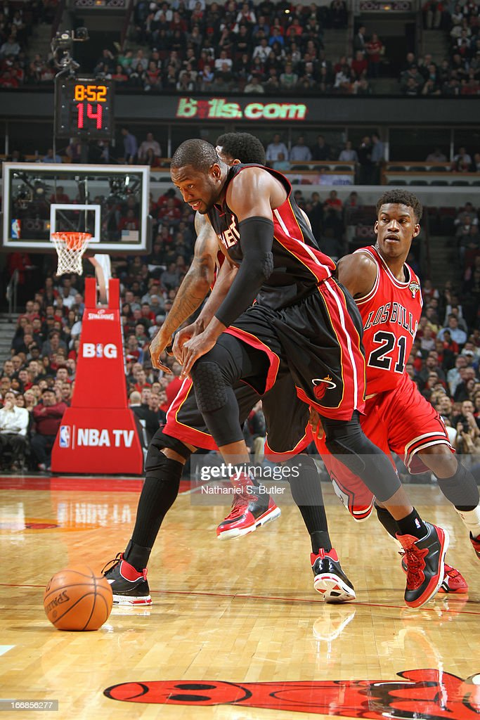 <a gi-track='captionPersonalityLinkClicked' href=/galleries/search?phrase=Dwyane+Wade&family=editorial&specificpeople=201481 ng-click='$event.stopPropagation()'>Dwyane Wade</a> #3 of the Miami Heat dribbles the ball around a defender against the Chicago Bulls on March 27, 2013 at the United Center in Chicago, Illinois.