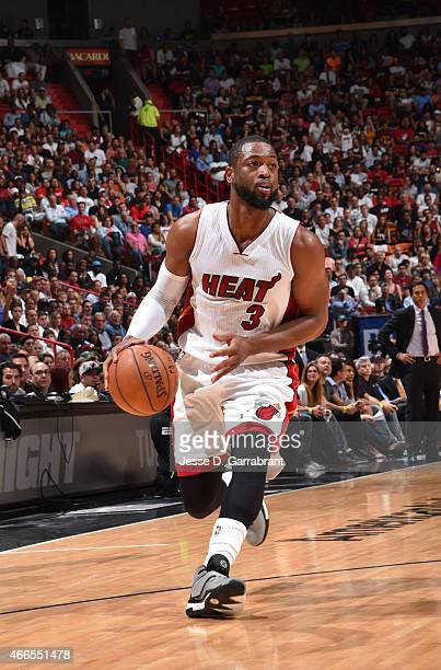 Dwyane Wade of the Miami Heat dribbles up the court against the Cleveland Cavaliers at the American Airlines Arena on March 16 2015 in...