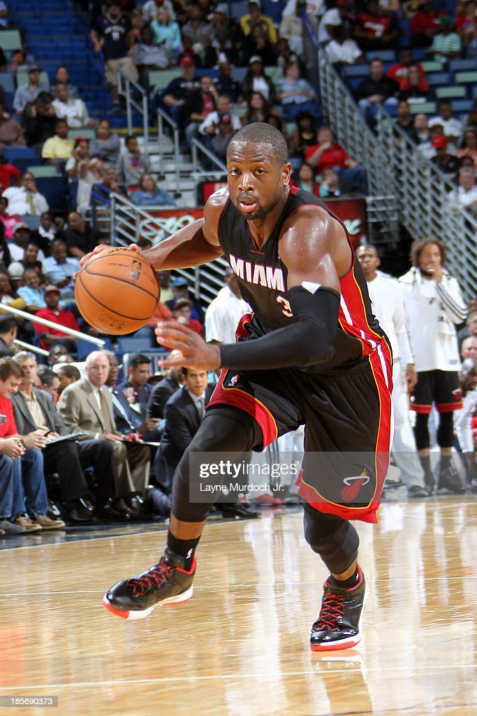 <a gi-track='captionPersonalityLinkClicked' href=/galleries/search?phrase=Dwyane+Wade&family=editorial&specificpeople=201481 ng-click='$event.stopPropagation()'>Dwyane Wade</a> #3 of the Miami Heat dribbles up the floor against the New Orleans Pelicans during an NBA preseason game on October 23,2013 at the New Orleans Arena in New Orleans, Louisiana.