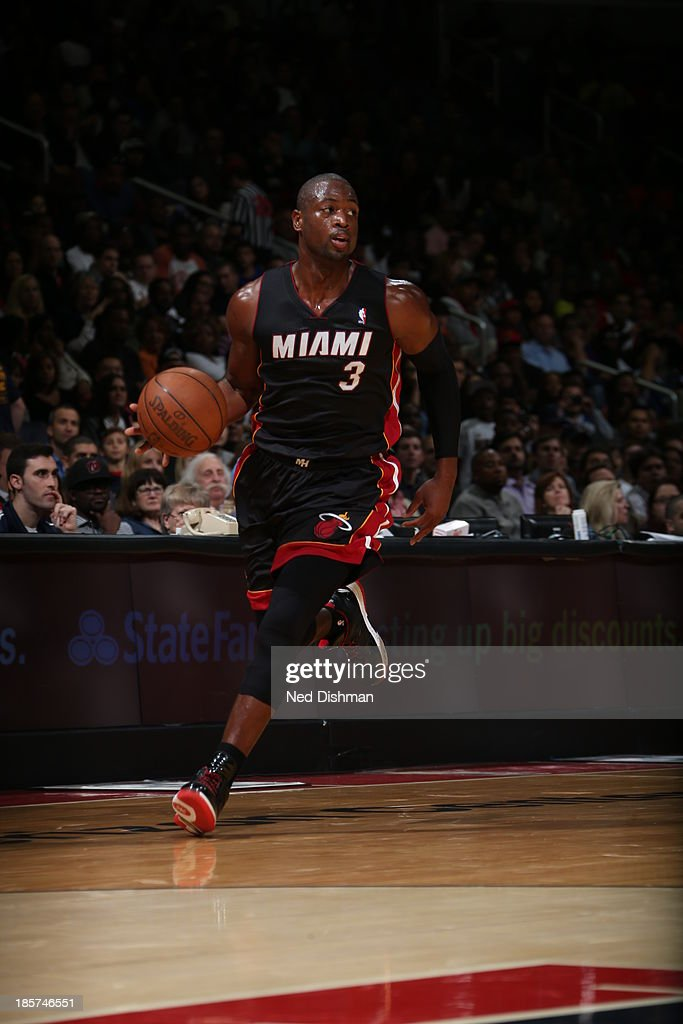 <a gi-track='captionPersonalityLinkClicked' href=/galleries/search?phrase=Dwyane+Wade&family=editorial&specificpeople=201481 ng-click='$event.stopPropagation()'>Dwyane Wade</a> #3 of the Miami Heat dribbles up the floor against the Washington Wizards during the pre-season game at the Verizon Center on October 15, 2013 in Washington, DC.
