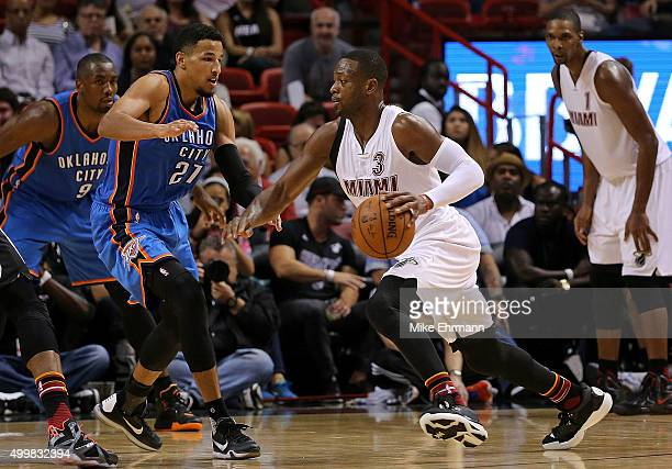 Dwyane Wade of the Miami Heat drivees on Andre Roberson of the Oklahoma City Thunder during a game at American Airlines Arena on December 3 2015 in...