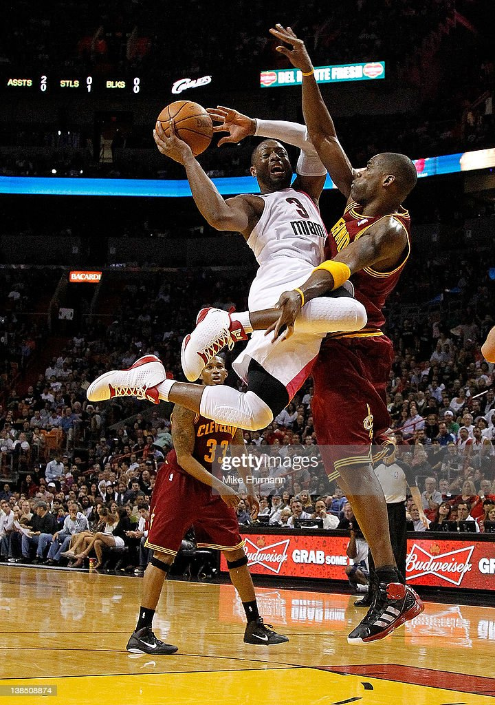 Dwyane Wade #3 of the Miami Heat drives against Antawn Jamison #4 of the Cleveland Cavaliers during a game at American Airlines Arena on February 7, 2012 in Miami, Florida.
