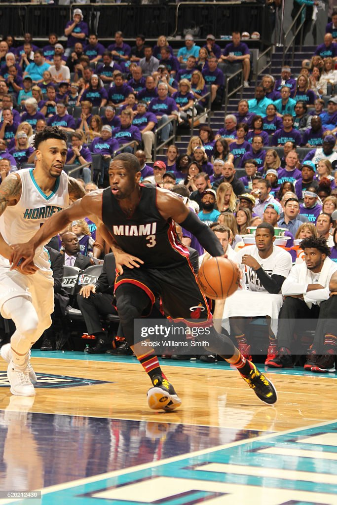 <a gi-track='captionPersonalityLinkClicked' href=/galleries/search?phrase=Dwyane+Wade&family=editorial&specificpeople=201481 ng-click='$event.stopPropagation()'>Dwyane Wade</a> #3 of the Miami Heat drives against <a gi-track='captionPersonalityLinkClicked' href=/galleries/search?phrase=Courtney+Lee&family=editorial&specificpeople=730223 ng-click='$event.stopPropagation()'>Courtney Lee</a> #1 of the Charlotte Hornets in Game Six of the Eastern Conference Quarterfinals during the 2016 NBA Playoffs on April 29, 2016 at Time Warner Cable Arena in Charlotte, North Carolina.