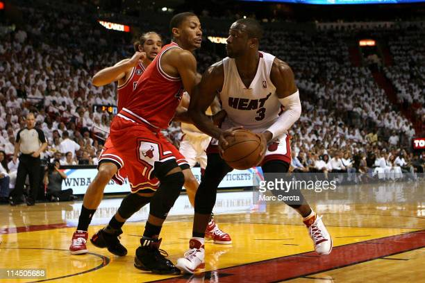 Dwyane Wade of the Miami Heat drives against Derrick Rose of the Chicago Bulls in Game Three of the Eastern Conference Finals during the 2011 NBA...
