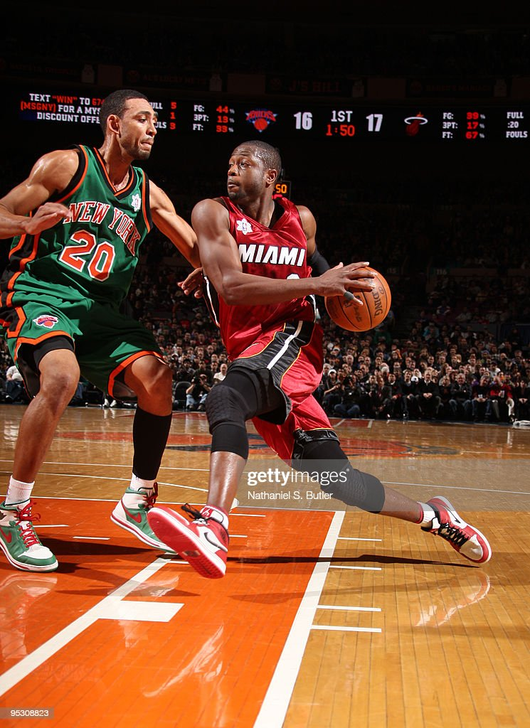 <a gi-track='captionPersonalityLinkClicked' href=/galleries/search?phrase=Dwyane+Wade&family=editorial&specificpeople=201481 ng-click='$event.stopPropagation()'>Dwyane Wade</a> #3 of the Miami Heat drives against <a gi-track='captionPersonalityLinkClicked' href=/galleries/search?phrase=Jared+Jeffries&family=editorial&specificpeople=202548 ng-click='$event.stopPropagation()'>Jared Jeffries</a> #20 of the New York Knicks on December 25, 2009 at Madison Square Garden in New York City.