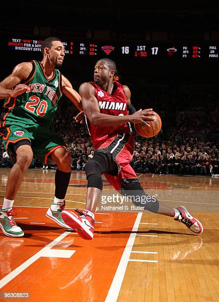 Dwyane Wade of the Miami Heat drives against Jared Jeffries of the New York Knicks on December 25 2009 at Madison Square Garden in New York City NOTE...
