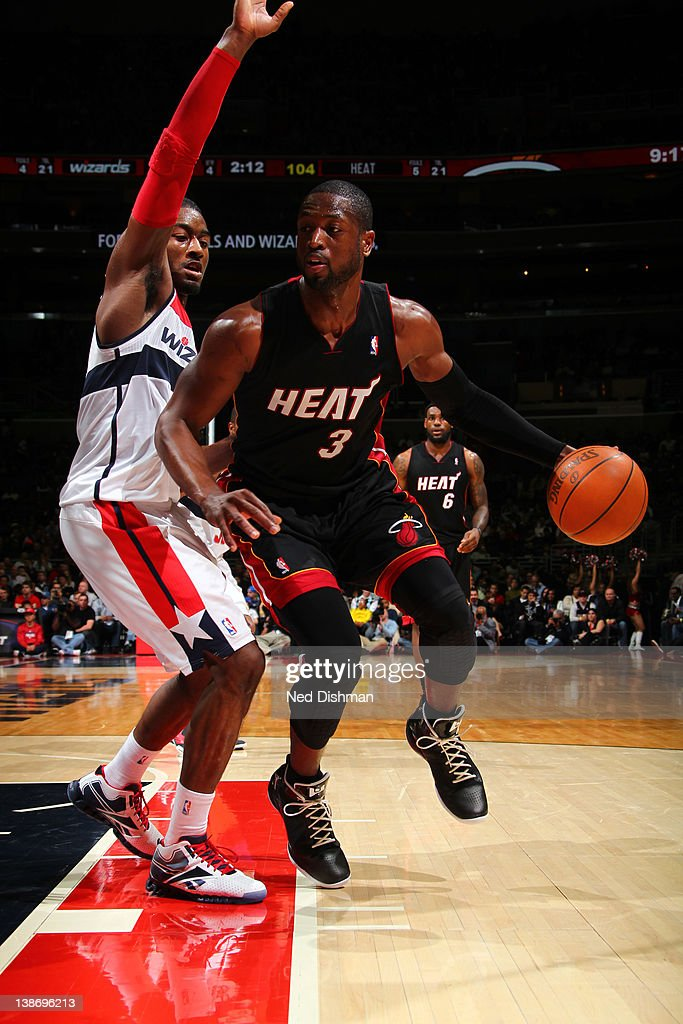 <a gi-track='captionPersonalityLinkClicked' href=/galleries/search?phrase=Dwyane+Wade&family=editorial&specificpeople=201481 ng-click='$event.stopPropagation()'>Dwyane Wade</a> #3 of the Miami Heat drives against <a gi-track='captionPersonalityLinkClicked' href=/galleries/search?phrase=John+Wall&family=editorial&specificpeople=2265812 ng-click='$event.stopPropagation()'>John Wall</a> #2 of the Washington Wizards during the game at the Verizon Center on February 10, 2012 in Washington, DC.