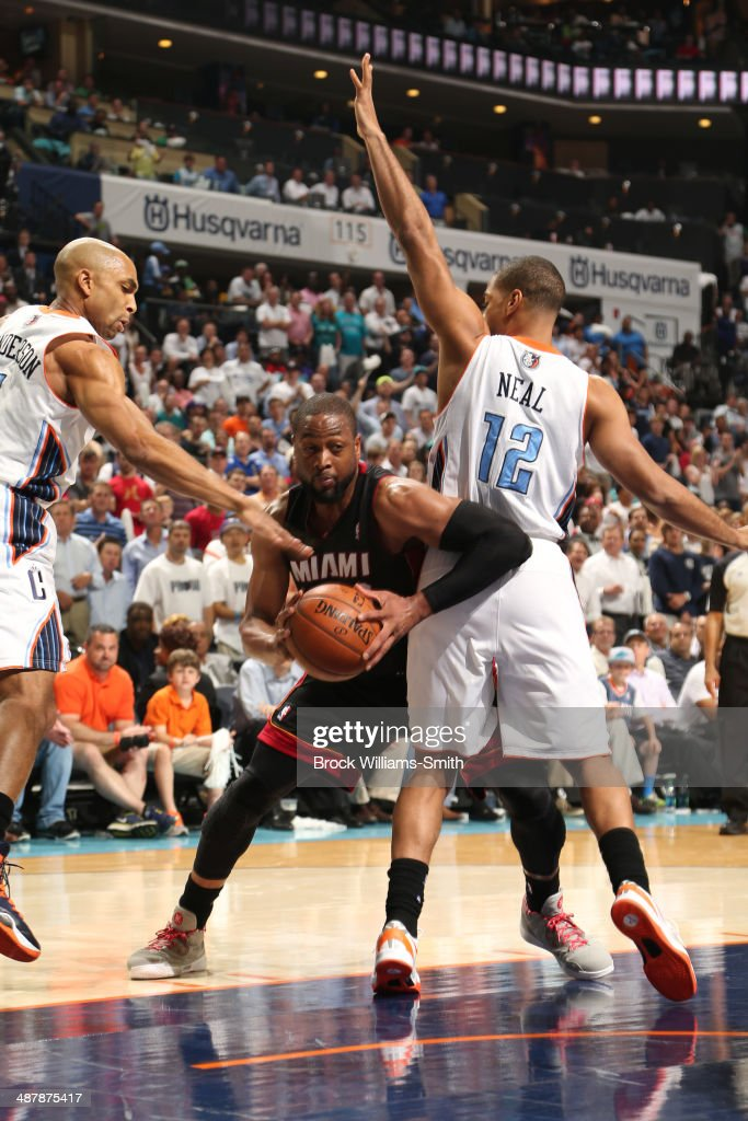 <a gi-track='captionPersonalityLinkClicked' href=/galleries/search?phrase=Dwyane+Wade&family=editorial&specificpeople=201481 ng-click='$event.stopPropagation()'>Dwyane Wade</a> #3 of the Miami Heat drives against the Charlotte Bobcats in Game One of the Eastern Conference Quarterfinals of the 2014 NBA playoffs at the Time Warner Cable Arena on April 28, 2014 in Charlotte, North Carolina.