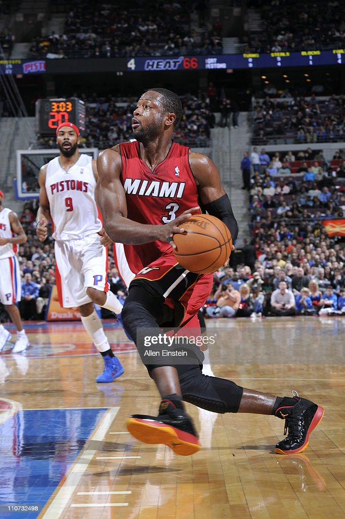 <a gi-track='captionPersonalityLinkClicked' href=/galleries/search?phrase=Dwyane+Wade&family=editorial&specificpeople=201481 ng-click='$event.stopPropagation()'>Dwyane Wade</a> #3 of the Miami Heat drives against the Detroit Pistons on March 23, 2011 at The Palace of Auburn Hills in Auburn Hills, Michigan.