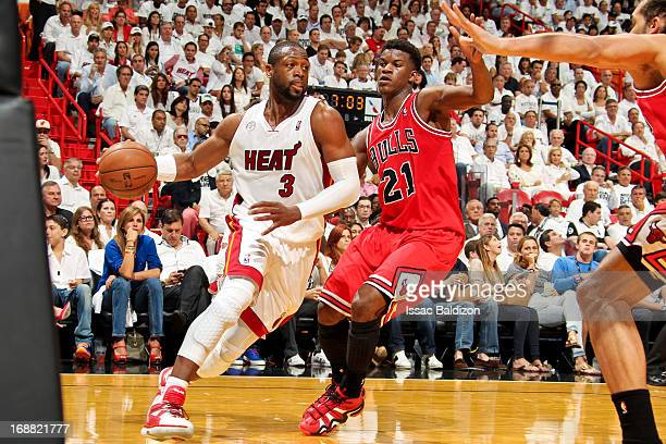 Dwyane Wade of the Miami Heat drives baseline against Jimmy Butler of the Chicago Bulls in Game Five of the Eastern Conference Semifinals during the...