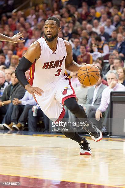 Dwyane Wade of the Miami Heat drives during the first half against the Cleveland Cavaliers at Quicken Loans Arena on April 2 2015 in Cleveland Ohio...
