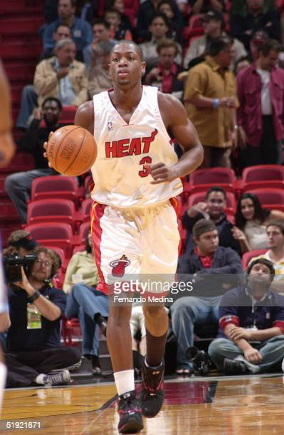 Dwyane Wade of the Miami Heat drives during the game against the Denver Nuggets at American Airlines Arena on December 17 2004 in Miami Florida The...