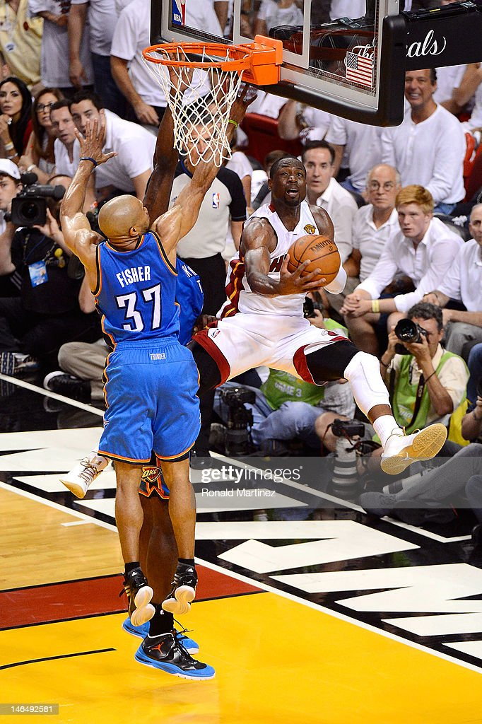 Dwyane Wade #3 of the Miami Heat drives for a shot attempt against Derek Fisher #37 of the Oklahoma City Thunder in Game Three of the 2012 NBA Finals on June 17, 2012 at American Airlines Arena in Miami, Florida.