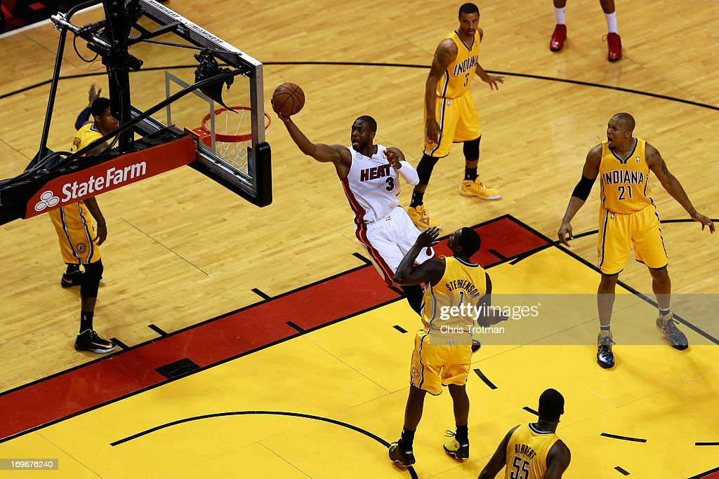<a gi-track='captionPersonalityLinkClicked' href=/galleries/search?phrase=Dwyane+Wade&family=editorial&specificpeople=201481 ng-click='$event.stopPropagation()'>Dwyane Wade</a> #3 of the Miami Heat drives for a shot attempt against <a gi-track='captionPersonalityLinkClicked' href=/galleries/search?phrase=Lance+Stephenson&family=editorial&specificpeople=5298304 ng-click='$event.stopPropagation()'>Lance Stephenson</a> #1 of the Indiana Pacers in the first quarter during Game Seven of the Eastern Conference Finals of the 2013 NBA Playoffs at AmericanAirlines Arena on June 3, 2013 in Miami, Florida.