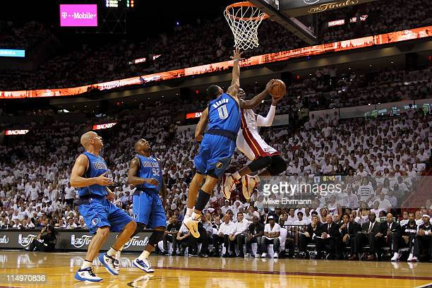 Dwyane Wade of the Miami Heat drives for a shot attempt against Shawn Marion of the Dallas Mavericks in Game One of the 2011 NBA Finals at American...