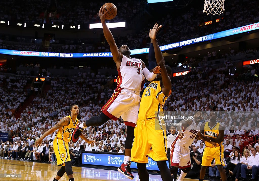 <a gi-track='captionPersonalityLinkClicked' href=/galleries/search?phrase=Dwyane+Wade&family=editorial&specificpeople=201481 ng-click='$event.stopPropagation()'>Dwyane Wade</a> #3 of the Miami Heat drives for a shot attempt in the first quarter against Roy Hibbert #55 of the Indiana Pacers during Game Seven of the Eastern Conference Finals of the 2013 NBA Playoffs at AmericanAirlines Arena on June 3, 2013 in Miami, Florida.