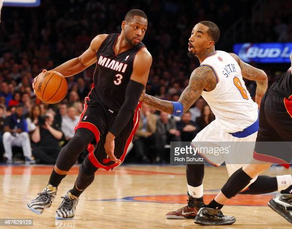 Dwyane Wade of the Miami Heat drives past JR Smith of the New York Knicks at Madison Square Garden on February 1 2014 in New York City The Heat...