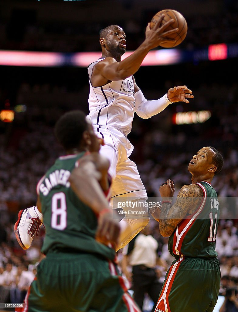 Dwyane Wade #3 of the Miami Heat drives past Monta Ellis #11 of the Milwaukee Bucks during Game 2 of the Eastern Conference Quarterfinals of the 2013 NBA Playoffs at American Airlines Arena on April 23, 2013 in Miami, Florida.