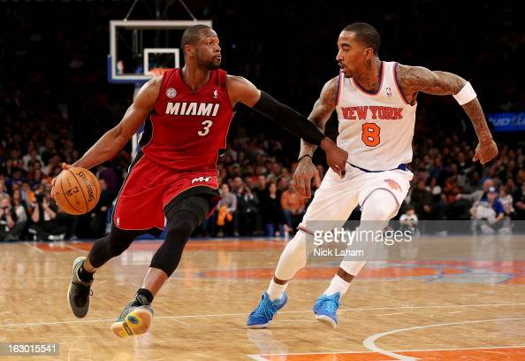 Dwyane Wade of the Miami Heat drives to the basket against JR Smith of the New York Knicks at Madison Square Garden on March 3 2013 in New York...