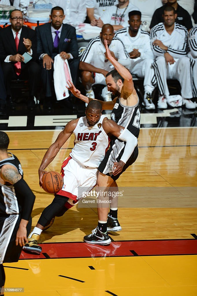 Dwyane Wade #3 of the Miami Heat drives to the basket against Manu Ginobili #20 of the San Antonio Spurs during Game Seven of the 2013 NBA Finals on June 20, 2013 at American Airlines Arena in Miami, Florida.