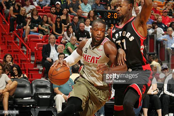 Dwyane Wade of the Miami Heat drives to the basket against Terrence Ross of the Toronto Raptors during the game on November 8 2015 at American...