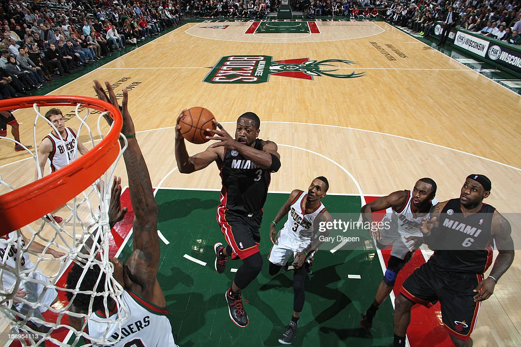 <a gi-track='captionPersonalityLinkClicked' href=/galleries/search?phrase=Dwyane+Wade&family=editorial&specificpeople=201481 ng-click='$event.stopPropagation()'>Dwyane Wade</a> #3 of the Miami Heat drives to the basket against the Milwaukee Bucks on December 29, 2012 at the BMO Harris Bradley Center in Milwaukee, Wisconsin.