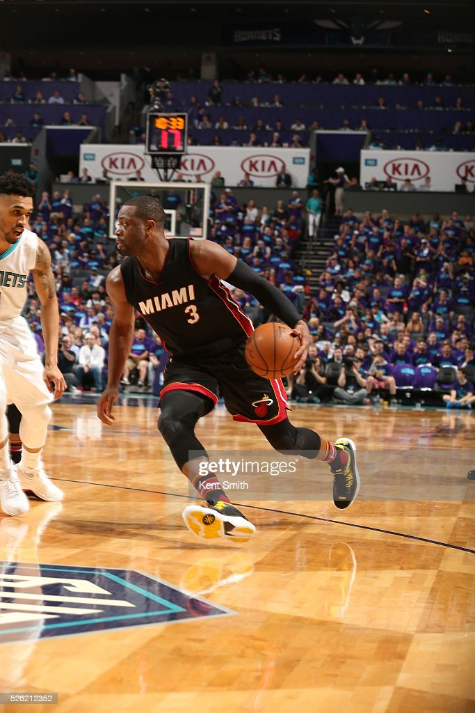 <a gi-track='captionPersonalityLinkClicked' href=/galleries/search?phrase=Dwyane+Wade&family=editorial&specificpeople=201481 ng-click='$event.stopPropagation()'>Dwyane Wade</a> #3 of the Miami Heat drives to the basket against the Charlotte Hornets in Game Six of the Eastern Conference Quarterfinals during the 2016 NBA Playoffs on April 29, 2016 at Time Warner Cable Arena in Charlotte, North Carolina.