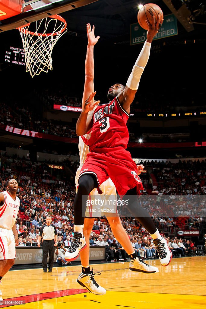 Dwyane Wade #3 of the Miami Heat drives to the basket against the Houston Rockets on February 6, 2013 at American Airlines Arena in Miami, Florida.