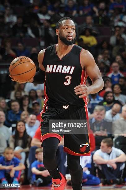 Dwyane Wade of the Miami Heat drives to the basket against the Detroit Pistons during the game on April 4 2015 at The Palace of Auburn Hills in...