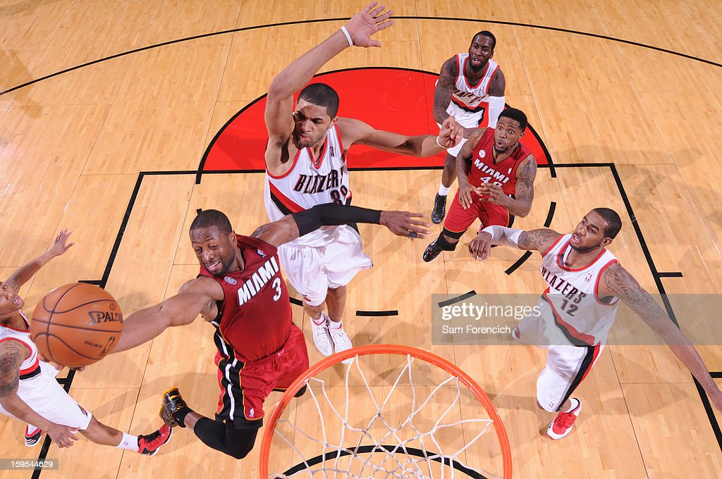 <a gi-track='captionPersonalityLinkClicked' href=/galleries/search?phrase=Dwyane+Wade&family=editorial&specificpeople=201481 ng-click='$event.stopPropagation()'>Dwyane Wade</a> #3 of the Miami Heat drives to the basket against the Portland Trail Blazers on January 10, 2013 at the Rose Garden Arena in Portland, Oregon.
