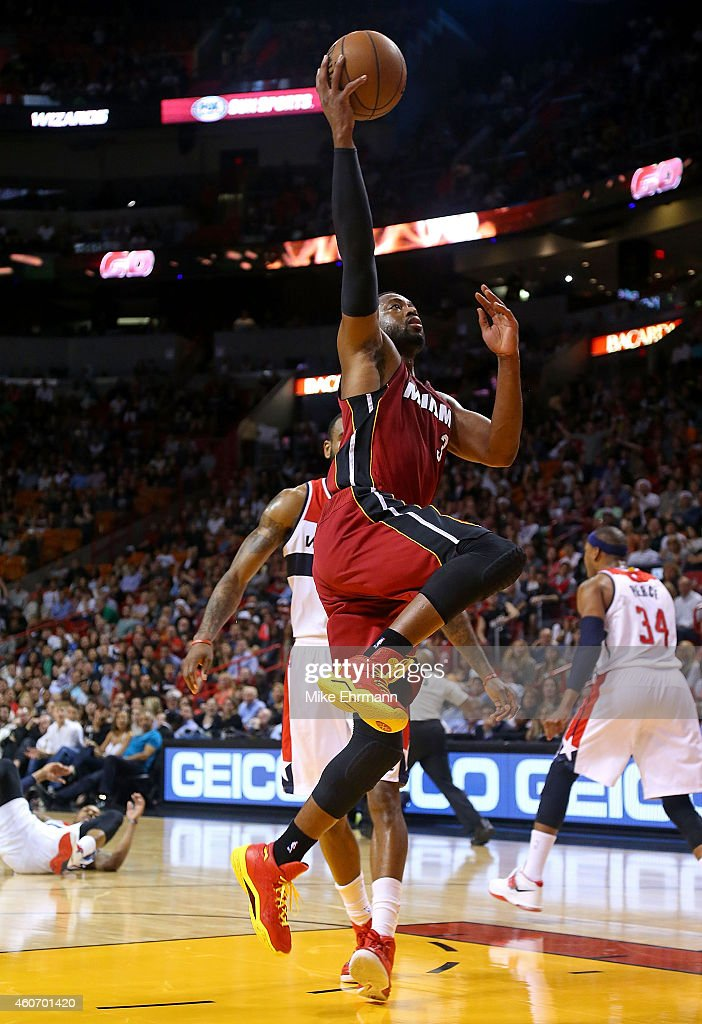 Dwyane Wade #3 of the Miami Heat drives to the basket during a game against the Washington Wizards at American Airlines Arena on December 19, 2014 in Miami, Florida.