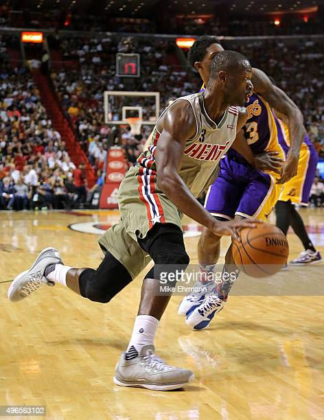 Dwyane Wade of the Miami Heat drives to the basket during a game against the Los Angeles Lakers at American Airlines Arena on November 10 2015 in...