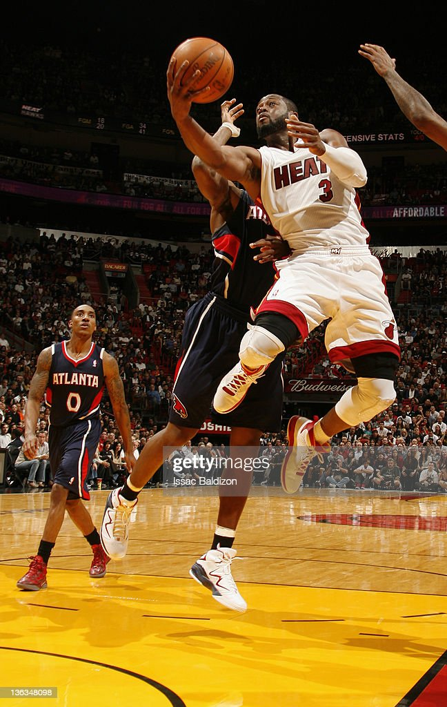 <a gi-track='captionPersonalityLinkClicked' href=/galleries/search?phrase=Dwyane+Wade&family=editorial&specificpeople=201481 ng-click='$event.stopPropagation()'>Dwyane Wade</a> #3 of the Miami Heat drives to the basket during the second quarter against the Atlanta Hawks on January 2, 2012 at American Airlines Arena in Miami, Florida.