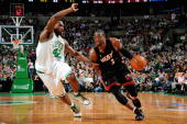 Dwyane Wade of the Miami Heat drives to the basket past Tony Allen of the Boston Celtics in Game Five of the Eastern Conference Quarterfinals during...