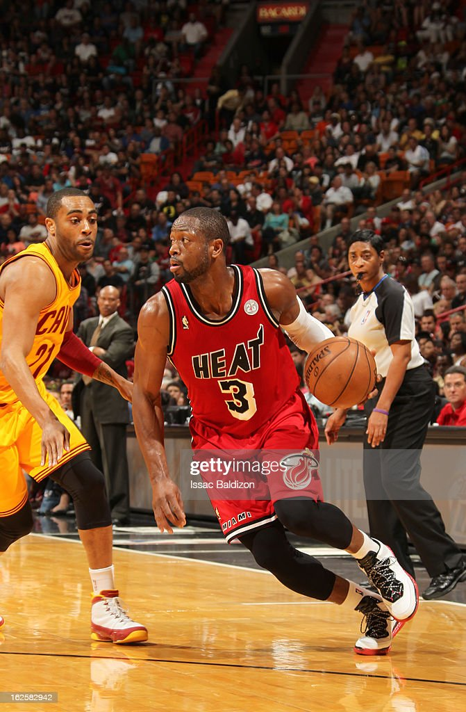 Dwyane Wade #3 of the Miami Heat drives up court against Wayne Ellington #21 of the Cleveland Cavaliers during a game between the Cleveland Cavaliers and the Miami Heat on February 24, 2013 at American Airlines Arena in Miami, Florida.