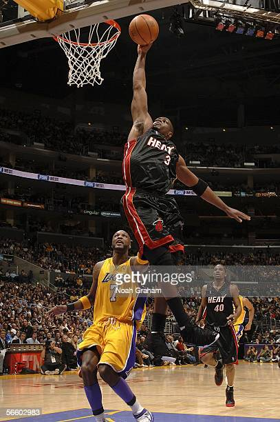 Dwyane Wade of the Miami Heat dunks against Lamar Odom of the Los Angeles Lakers on January 16 2006 at Staples Center in Los Angeles California NOTE...