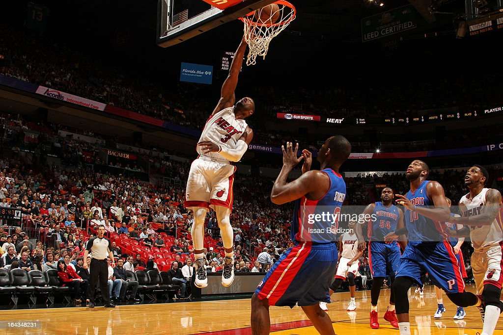 Dwyane Wade #3 of the Miami Heat dunks against Rodney Stuckey #3 of the Detroit Pistons on March 22, 2013 at American Airlines Arena in Miami, Florida.