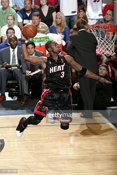 Dwyane Wade of the Miami Heat dunks against the Dallas Mavericks during Game Two of the 2006 NBA Finals on June 11 2006 at the American Airlines...