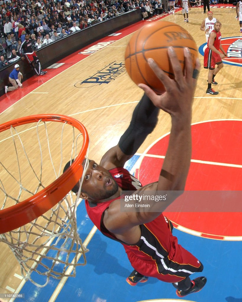 <a gi-track='captionPersonalityLinkClicked' href=/galleries/search?phrase=Dwyane+Wade&family=editorial&specificpeople=201481 ng-click='$event.stopPropagation()'>Dwyane Wade</a> #3 of the Miami Heat dunks against the Detroit Pistons on March 23, 2011 at The Palace of Auburn Hills in Auburn Hills, Michigan.