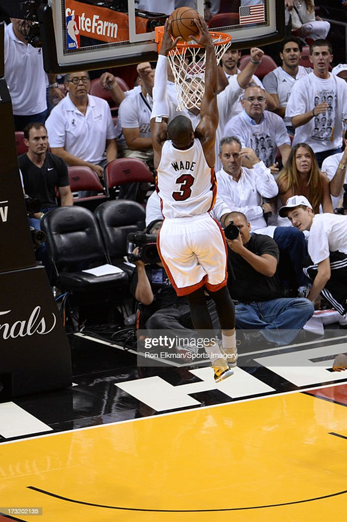 <a gi-track='captionPersonalityLinkClicked' href=/galleries/search?phrase=Dwyane+Wade&family=editorial&specificpeople=201481 ng-click='$event.stopPropagation()'>Dwyane Wade</a> #3 of the Miami Heat dunks against the San Antonio Spurs during Game Seven of the 2013 NBA Finals on June 20, 2013 at American Airlines Arena in Miami, Florida.