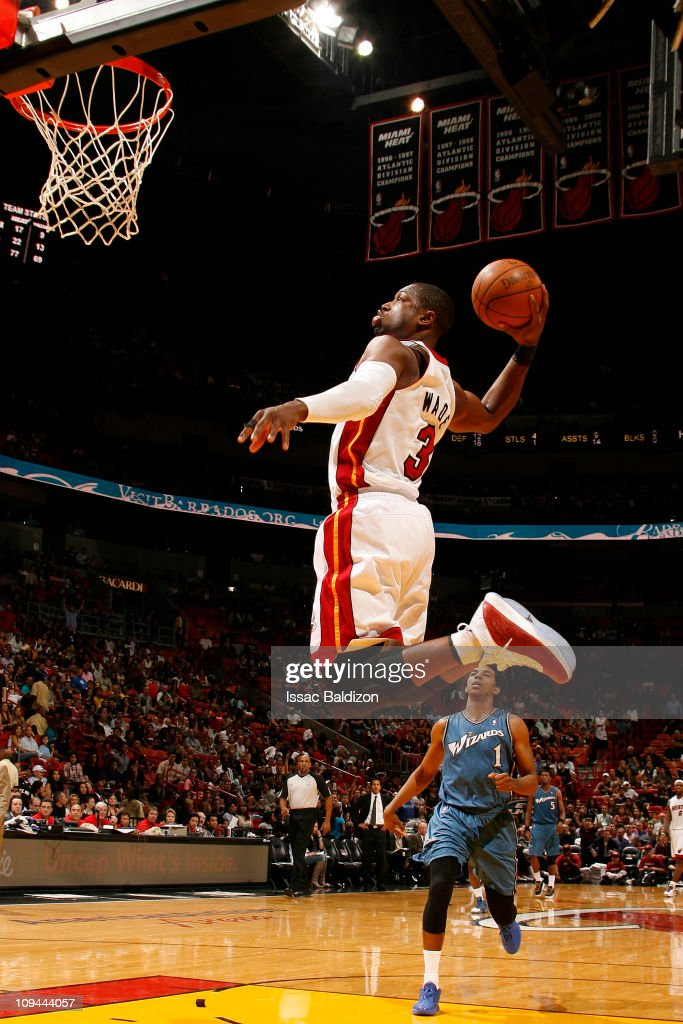 <a gi-track='captionPersonalityLinkClicked' href=/galleries/search?phrase=Dwyane+Wade&family=editorial&specificpeople=201481 ng-click='$event.stopPropagation()'>Dwyane Wade</a> #3 of the Miami Heat dunks against the Washington Wizards on February 25, 2011 at American Airlines Arena in Miami, Florida.