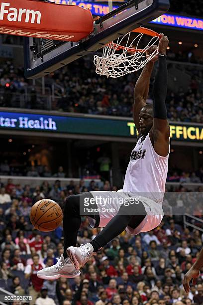 Dwyane Wade of the Miami Heat dunks against the Washington Wizards during the first half at Verizon Center on January 3 2016 in Washington DC NOTE TO...